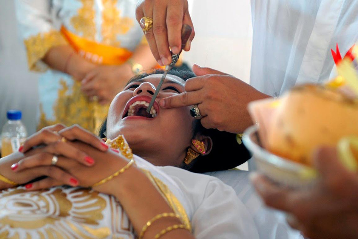 Metatah or Tooth filing - 5 Balinese Hindu Ceremonies You Should See in Bali
